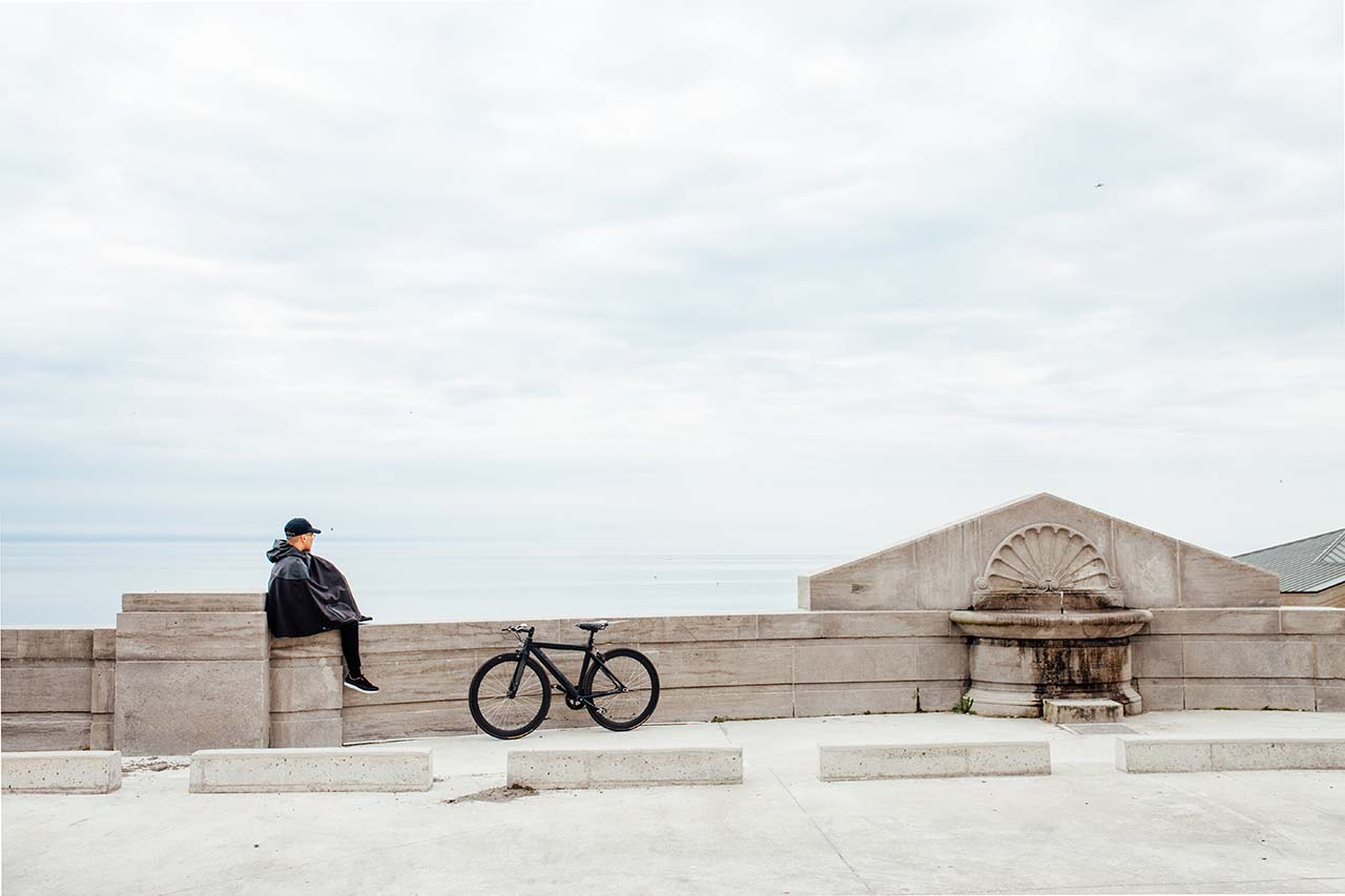 Craig sitting with bike