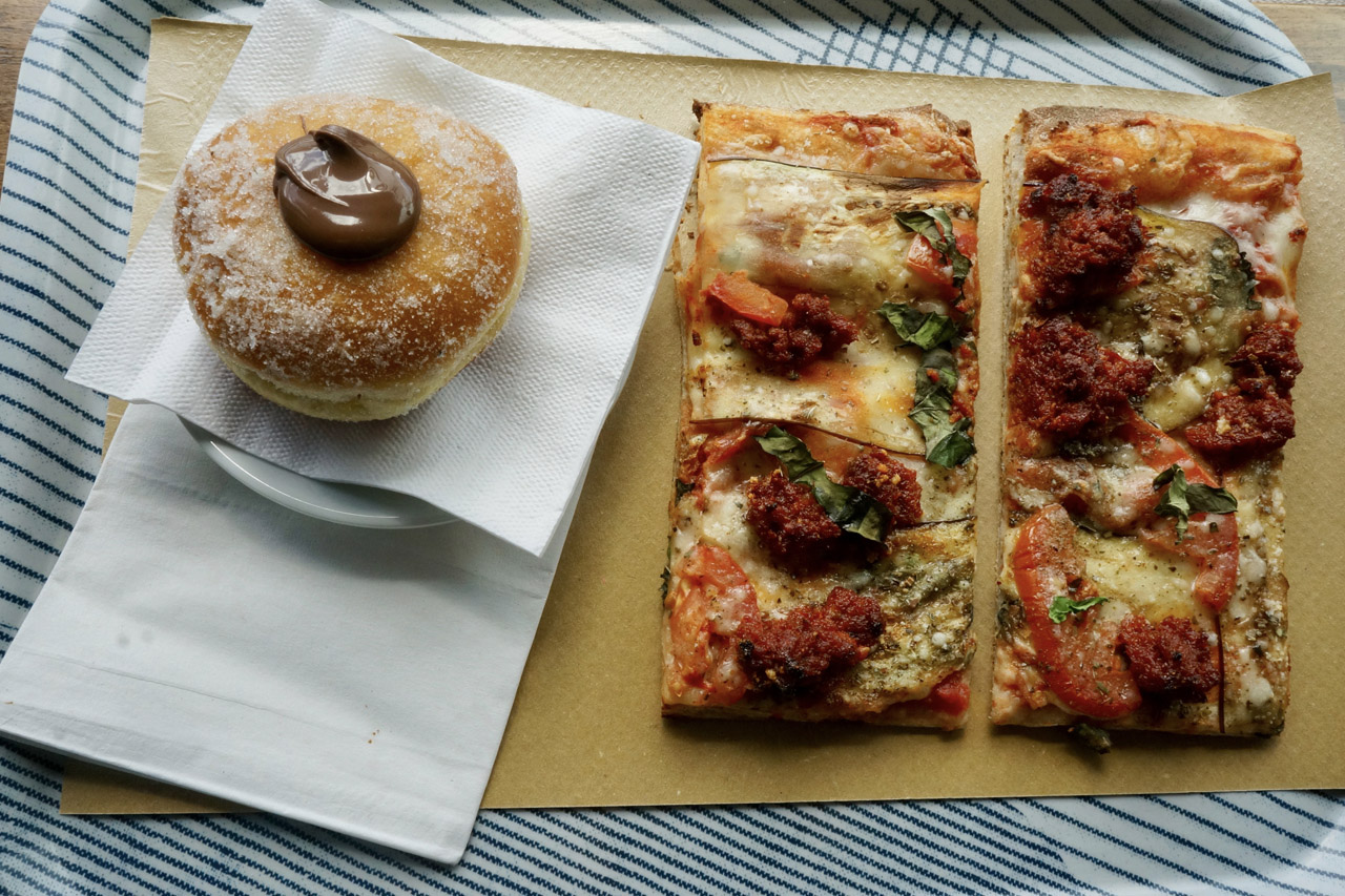 Enjoy pizza and a doughnut at Sud Forno