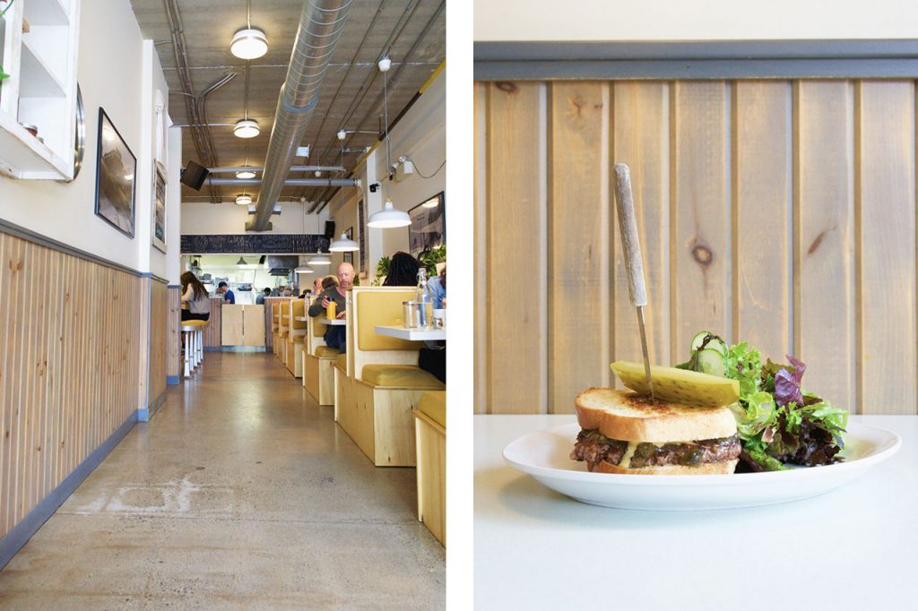 Diner interior paired with a sandwich and salad against a wood  wall backdrop