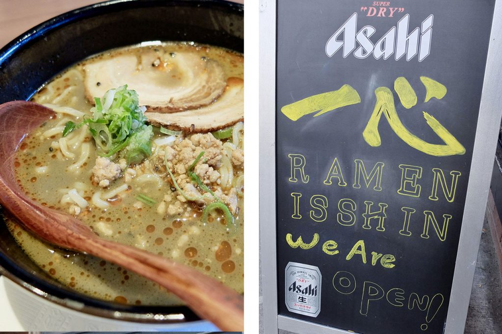 Creamy bowl of ramen with green onion garnish and a sidewalk open sign for Isshin restaurant.