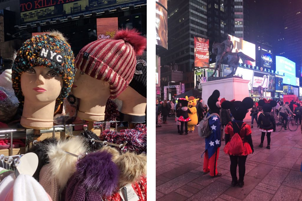 Mannequin heads with multicoloured toques and Mickey Mouse and Minny Mouse in Time Square at night