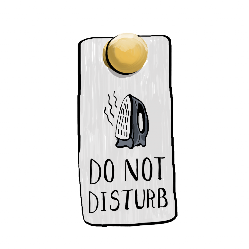 A hotel 'Do not disturb' doorknob sign with a iron.