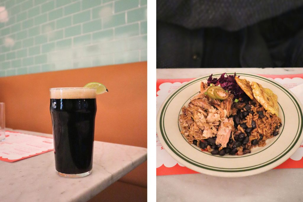 A pint of dark stout and a plate of rice and beans.